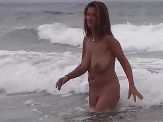 Gorgeous Milf first of all the beach surrounding boyfriend