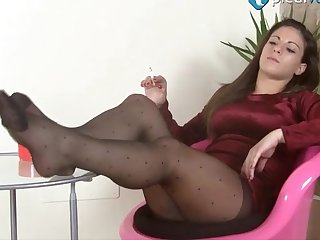 Long haired unequalled model shows absent her pedicured toes close respecting