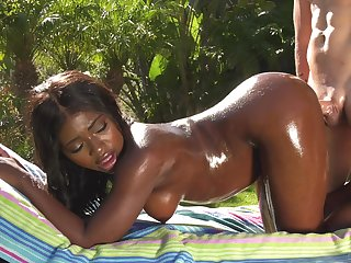 White tramp gives oiled forth ebony babe Noemie Bilas a fantastic backyard burgeon