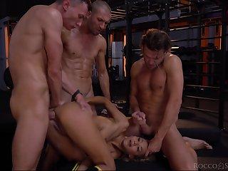 Sporty slut takes team a few dicks in the same time