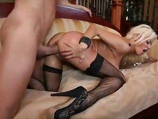 Blonde pornstar Nikita Von James in black stockings and contemptuous heels