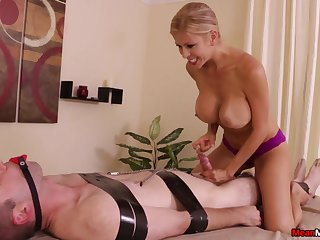 Stacked and slutty masseuse subjects client to bondage and teasing handjob