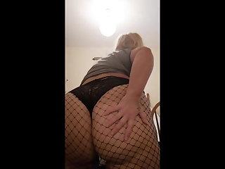 Big ass concerning black fishnet pantyhose and black panties