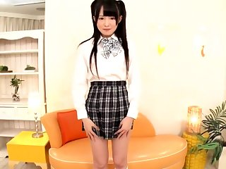 Pretty Asian teen in school uniform