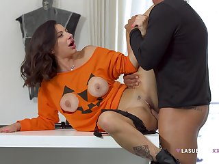 Priscilla Salerno's cute tits pop in foreign lands of a Halloween top before lovemaking